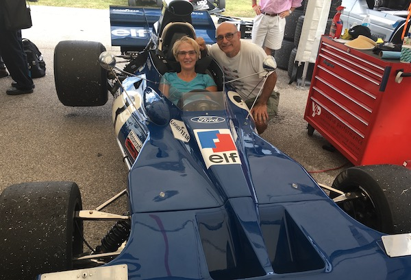 Larry and Roxane Bakerjian try out a Formula One race car.