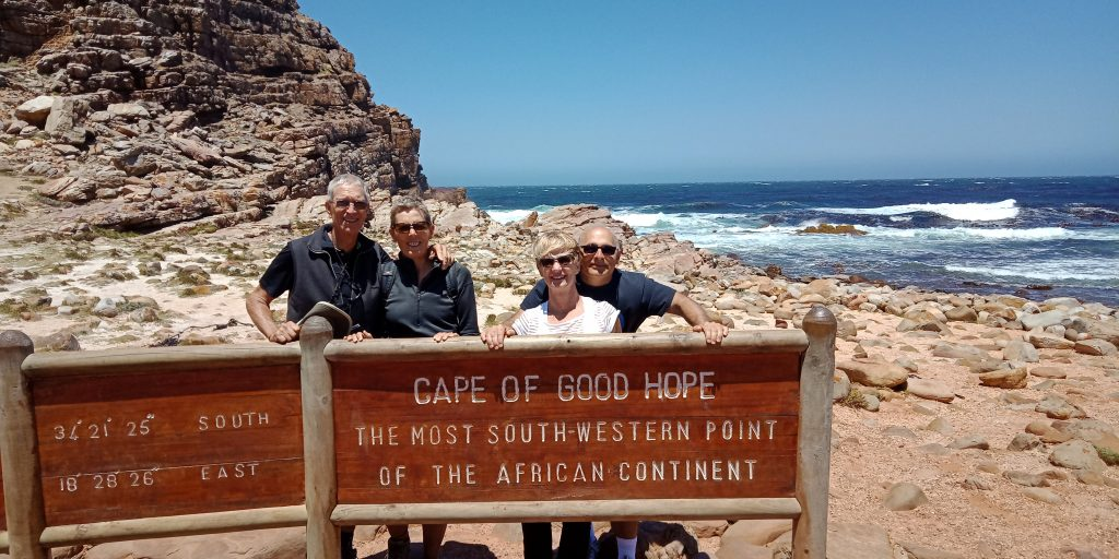 Jan and Rich (left) pose with Rox and Larry Bakerjian near Cape Town, South Africa, in 2018.