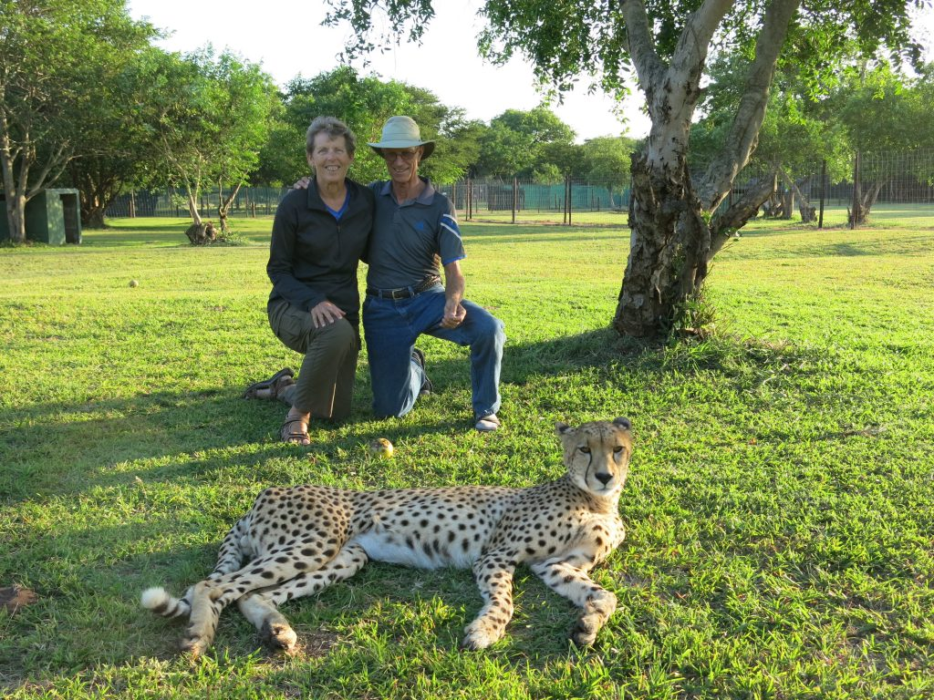 Jan and Rich with a cheetah at the Zululand Cat Conservation Project in South Africa.